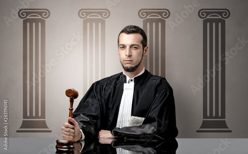 Fotografia Young judge in front of a courthouse symbol making decision