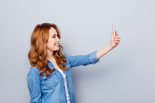 Close Up Side Profile Photo Beautiful Amazing She Her Curly Lady Hold Arm Hand Telephone Smart Phone Make Take Selfies Tell Speak Skype Wear Casual Blue Jeans Denim Shirt Isolated Grey Background