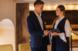 young businessmen guy and girl in a cozy interior have agreed, business and freelance