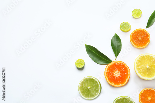 Flat lay composition with different citrus fruits on white background - 263207784