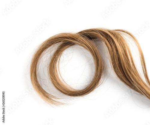 Fotografija Strand of beautiful light brown hair on white background, top view