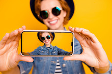 Close Up Photo Funny Funky Foxy She Her Lady Telephone Make Take Selfies Speak Tell Skype Wear Specs Vintage Hat Casual Striped T-shirt Jacket Jeans Denim Isolated Yellow Bright Blurred Background