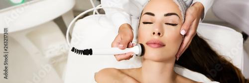 Obraz Beautiful woman in professional beauty salon during photo rejuvenation procedure - fototapety do salonu