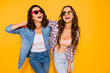 canvas print picture - Portrait beautiful cute charming teen teenagers satisfied content chill laughter touch hair free time weekends summer travel holidays spring dressed checked shirt denim isolated yellow background
