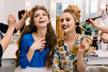 Preparation To Great Party Of Joyful Young Women In Hairdresser Salon. Expressing True Positive Emotions, Stylish Look, Fashionable Models, Beautiful Coiffure, Makeup, Beauty Service, Stylist