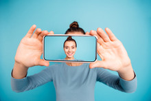 Portrait Of Her She Nice-looking Attractive Sweet Lovely Cheerful Cheery Girl Holding In Hand Cell Taking Selfie New Display Isolated Over Bright Vivid Shine Turquoise Background