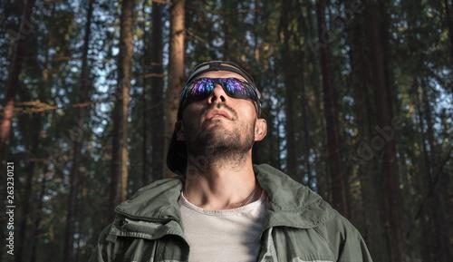Fotografie, Obraz  Male huntsman in the forest. He looks up