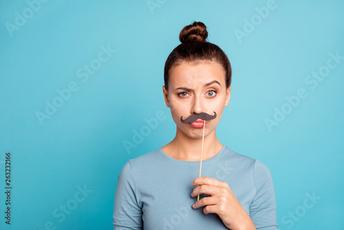Valokuvatapetti Close up portrait of carefree careless lady millennial hold hand make faces fool