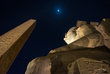 Statue Of Ramesses II And Obelisk At Night. Luxor Temple, Egypt