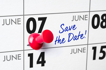 Wall calendar with a red pin - June 07