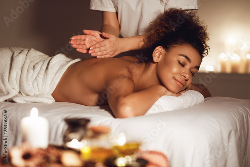 Obraz Body care. Woman enjoying relaxing back massage - fototapety do salonu