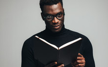 African Man With A Book