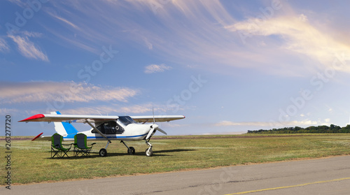 Front view of light aircraft with piston engine on airfield with two folding lou Canvas Print