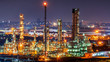 Leinwanddruck Bild - Oil refinery and​ industrial​ city​ After sunset