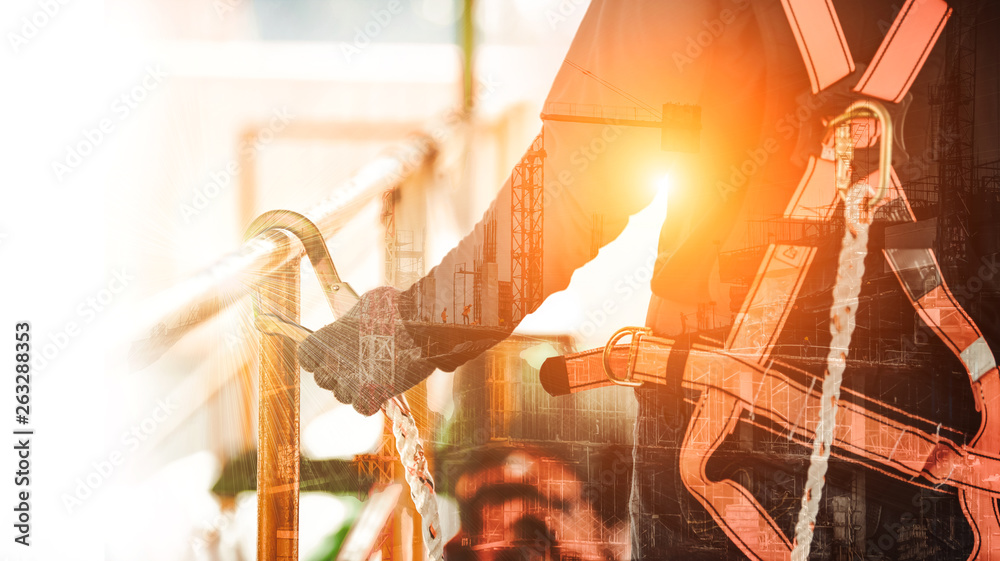 Fototapety, obrazy: Double exposure of Construction worker wearing safety harness and safety line working