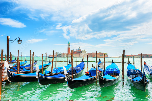 Gondolas on the Grand canal near San Marco square in Venice, Italy. San Giorgio Maggiore Cathedral in the background