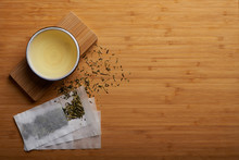 Japanese Kukicha Tea Spilled Outside Teabag And Boiled Tea In Cup.