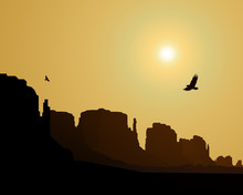 Western Desert. Rocks. Flying Eagles. Yellow Sky. Sunset .