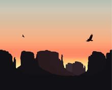 Western Desert. Rocks. Flying Eagles. Colorful Sky. Sunset.