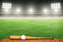 Baseball Bat And Ball On Field...