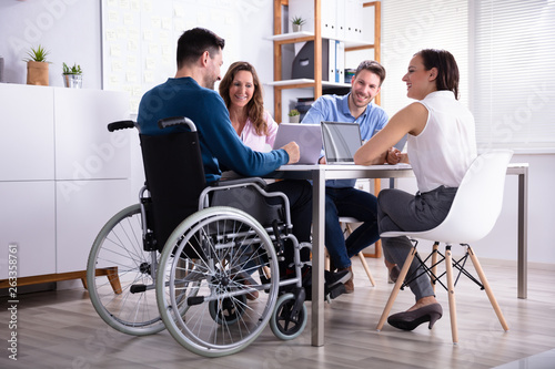 Obraz Disabled Manager Sitting With His Colleagues - fototapety do salonu