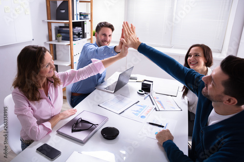 Photo  Group Of Businesspeople Giving High Five