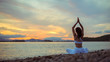 Rear view of healthy women practicing yoga. Sitting Sukhasana exercise, Easy Seat pose pose. .Amazing landscape and enjoying sea view with morning, copy space for text