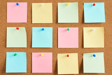 Cork Board With A Pinned Colored Blank Notes