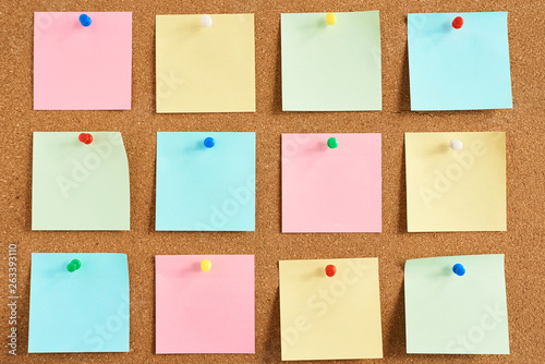 Cork board with a pinned colored blank notes Wallpaper Mural