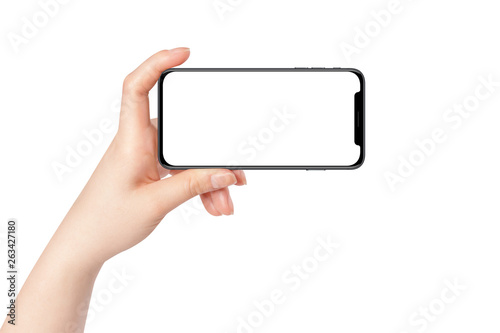 Fotografía Female hand hold modern smartphone in horizontal position, isolated on white background