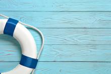 Sea Lifebuoy On Blue Wooden Background .