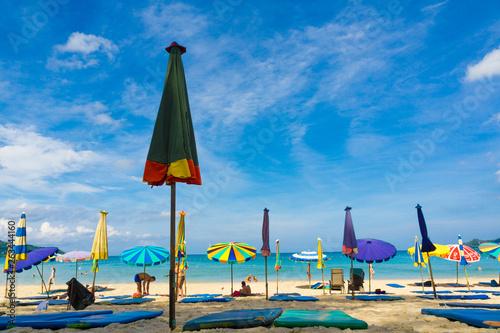 Fotografering Colorful umbrella on sea bech