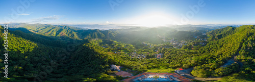 Fotomural  panoramic landscape and over the sunlight with blue sky background on the mounta