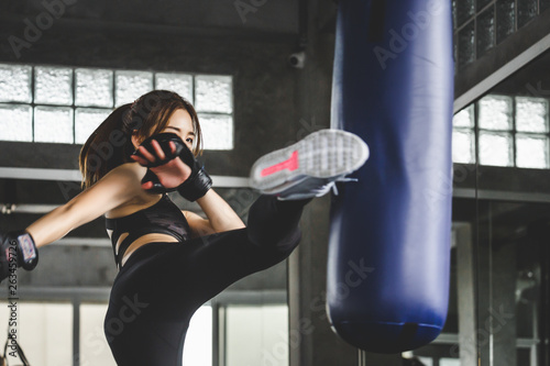 Athlete woman doing kick boxing training
