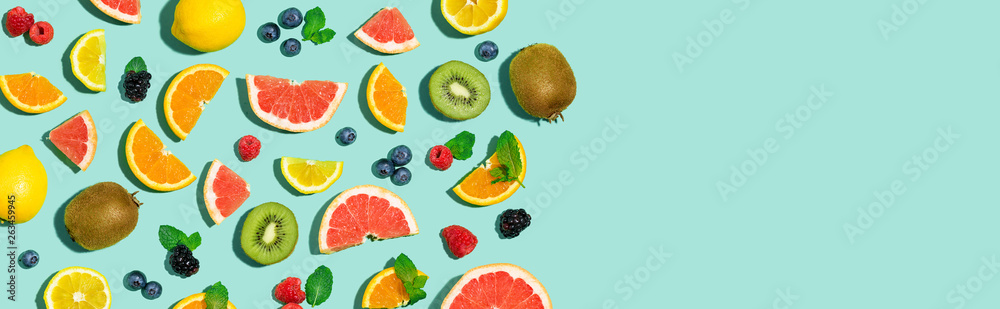 Fototapeta Collection of mixed fruits overhead view flat lay