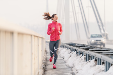 Beautiful fitness woman enjoying at winter morning. Winter fitness concept.