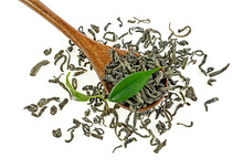 Green Tea Leaves And Dried Tea On A Wooden Spoon, White Background.