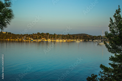 sea bay calming outdoor scenery landscape with yachts on water surface in evenin Fototapeta