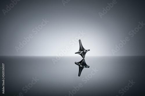 Fototapeta  Totem spinning top spinning, wobbling and stopping