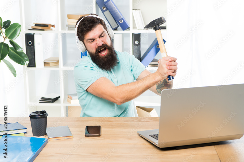 Fototapeta Outdated software. Computer lag. Reasons for computer lagging. How fix slow lagging system. Hate office routine. Man bearded guy headphones office swing hammer on computer. Slow internet connection
