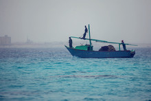 Wooden Fishing Boat Anchored In The Sea, Egypt