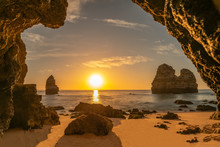 Beautiful Beach Photographed From A Cave At Sunrise