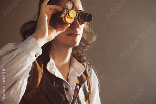 Fotografie, Obraz Steampunk style researcher mechanist of the monocle with a large number of lense