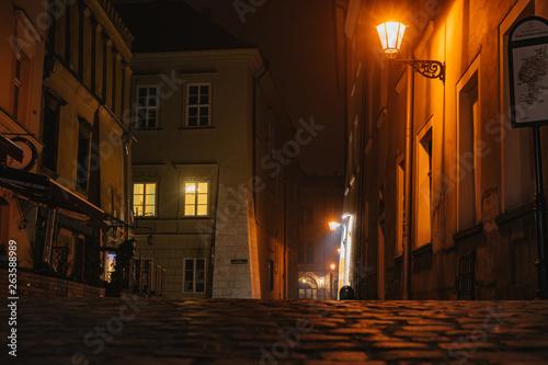 Fototapeten Schmale Gasse Night european ancient narrow street with warm illumination