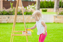 Little Girl Boy Drawing With Colorful Paints In Summer Park. Creative Child Painting On Nature. Talented Toddler Painter