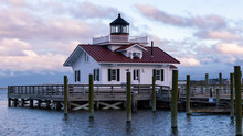 Sunset In Manteo, NC With A View Of The Roanoke Island Marshes Light. Tiny Lighthouse In The Outer Bank With A Beautiful Sky In The Background.