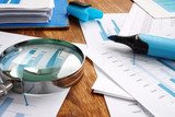 Fototapeta Coffie - Audit and financial accounting concept. Magnifier and business report.