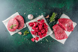 Various raw beef meat with spices and herbs, dark concrete background copy space - 263627730