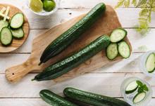 Sliced Cucumbers On Wood Chopp...