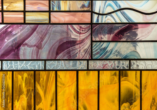 Naklejki na szyby  glass-stained-glass-with-colorful-graphic-pattern-abstract-trend-stained-glass-background